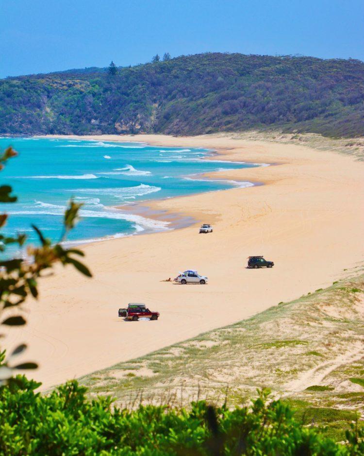 Four-wheel drives on Lighthouse Beach in Seal Rocks