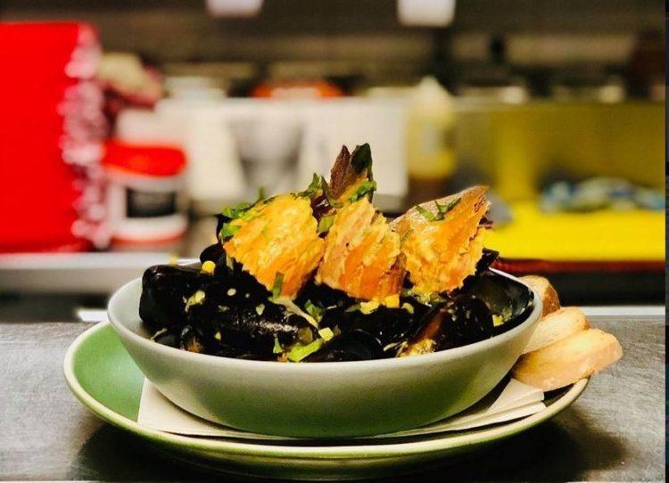 Black mussels with Balmain bugs in sweet corn broth