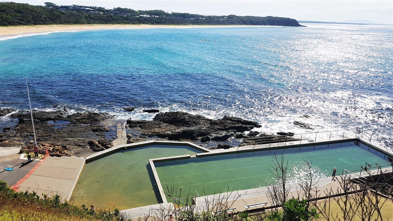 Black Head ocean baths with Black Head beach in background.
